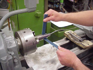 Image result for Polishing in lathe